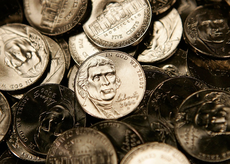 Nickels are shown, and like hidden fees, they can add up fast