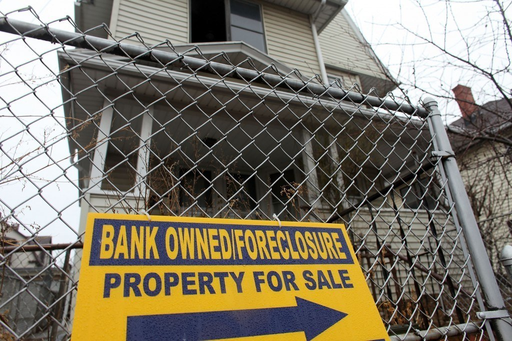 BRIDGEPORT, CT - MARCH 12: A sign is displayed in front of a foreclosed home on March 12, 2010 in Bridgeport, Connecticut. A new report by RealtyTrac Inc. announced that the number of foreclosed homes in Connecticut, one of the nation's wealthiest states, is up 3.4 percent from January to February of this year. Nationwide foreclosures have decreased by two percent from January to February. The report, which was released yesterday, says there were nearly 2,300 foreclosure filings in Connecticut last month, compared with nearly 2,200 in January. (Photo by Spencer Platt/Getty Images)