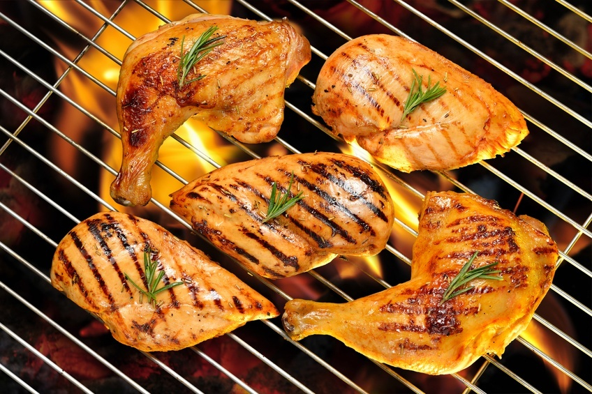 chicken pieces on a grill