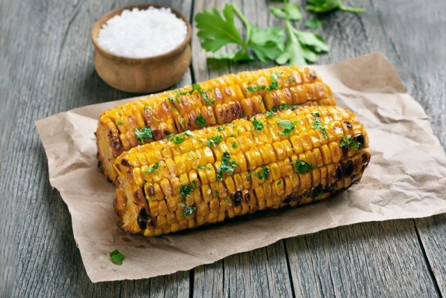 two grilled corn cobs