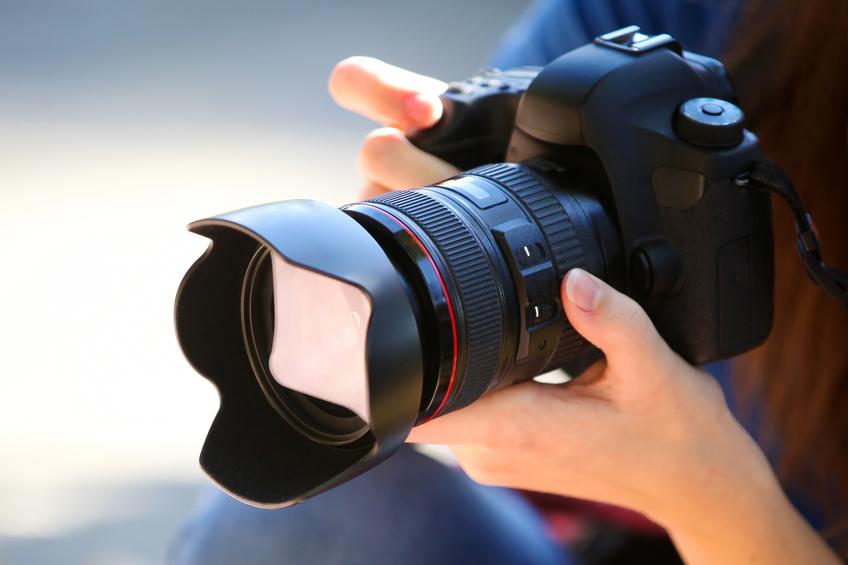 woman holding a camera