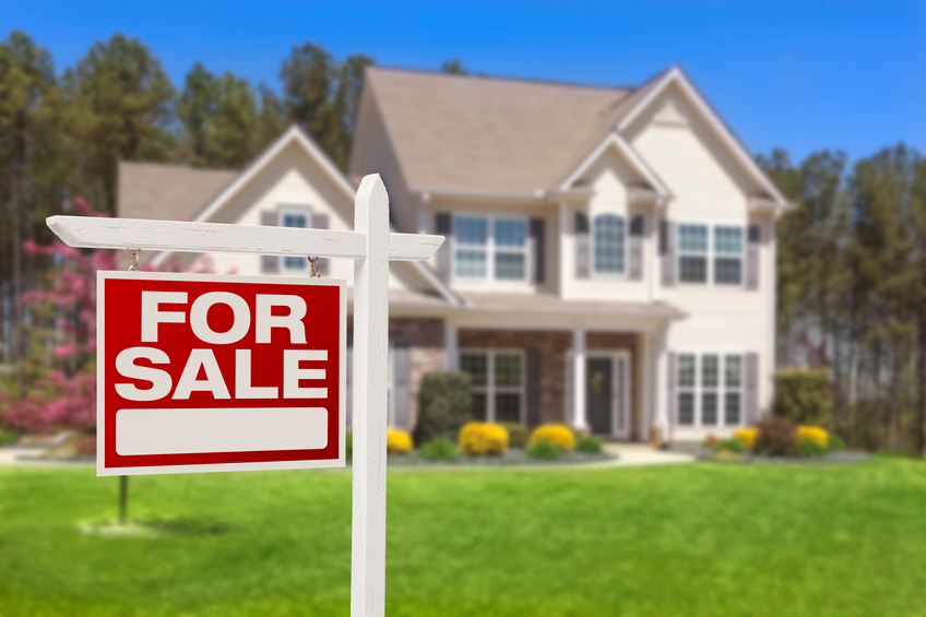 suburban home with for sale sign