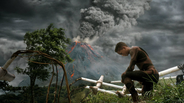 Jaden Smith is on one knee as a storm is coming in After Earth