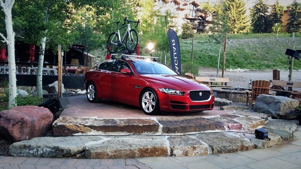A red Jaguar XE Sport Sedan on display.