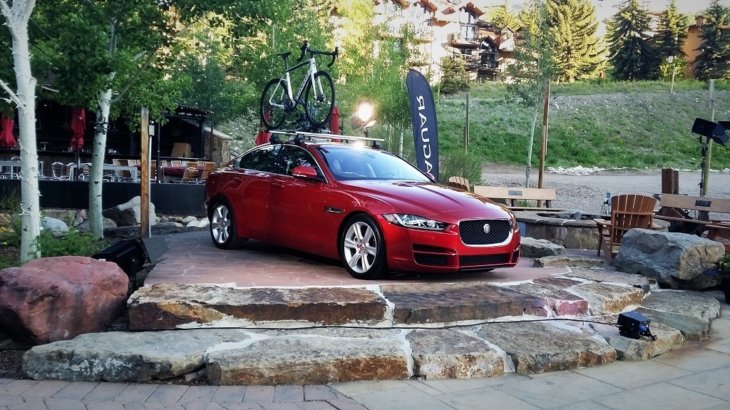 A red Jaguar XE Sport Sedan on display.