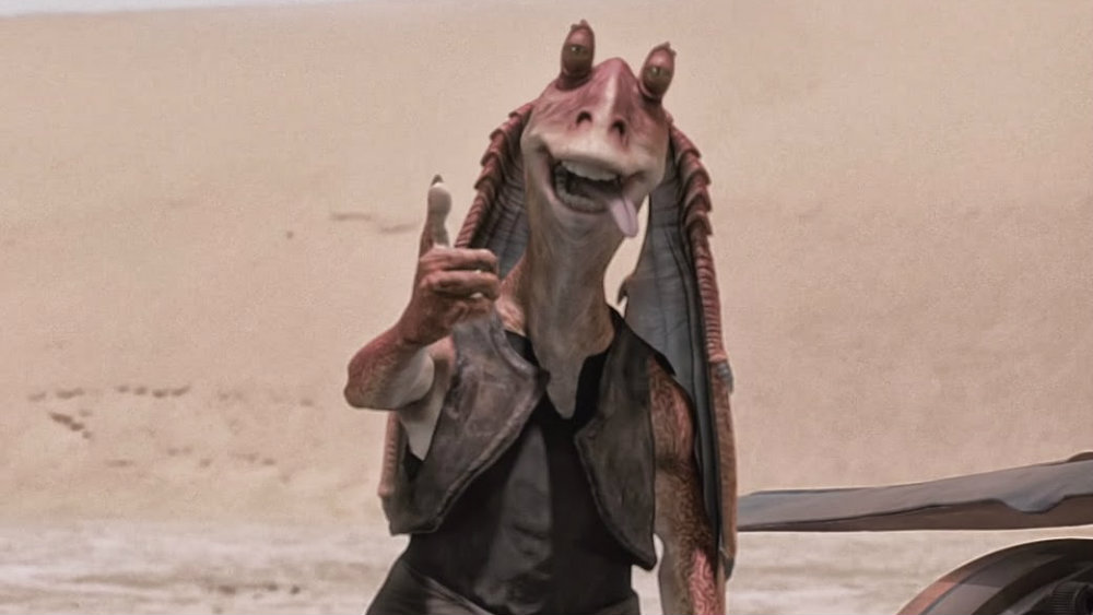 Jar Jar Binks with his thumb up and tongue lolling out of his mouth