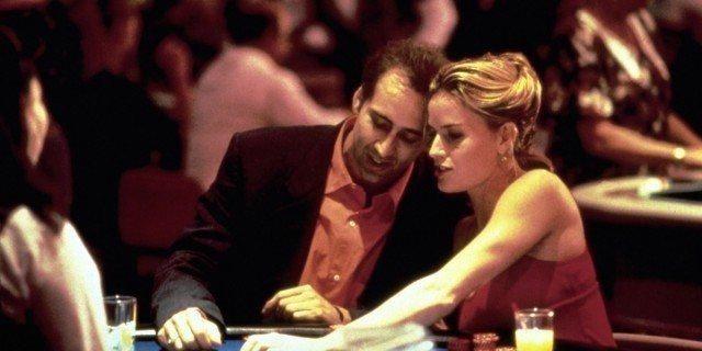 Nicolas Cage and Elisabeth Shue sit at a blackjack table in 'Leaving Las Vegas'.