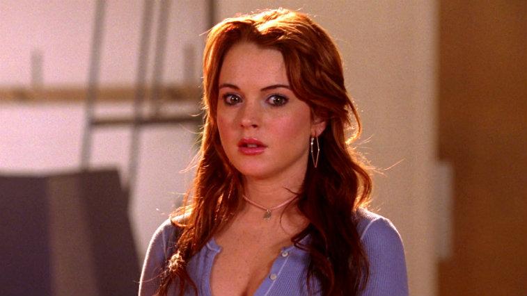 Lindsay Lohan looking surprised, wearing a purple top