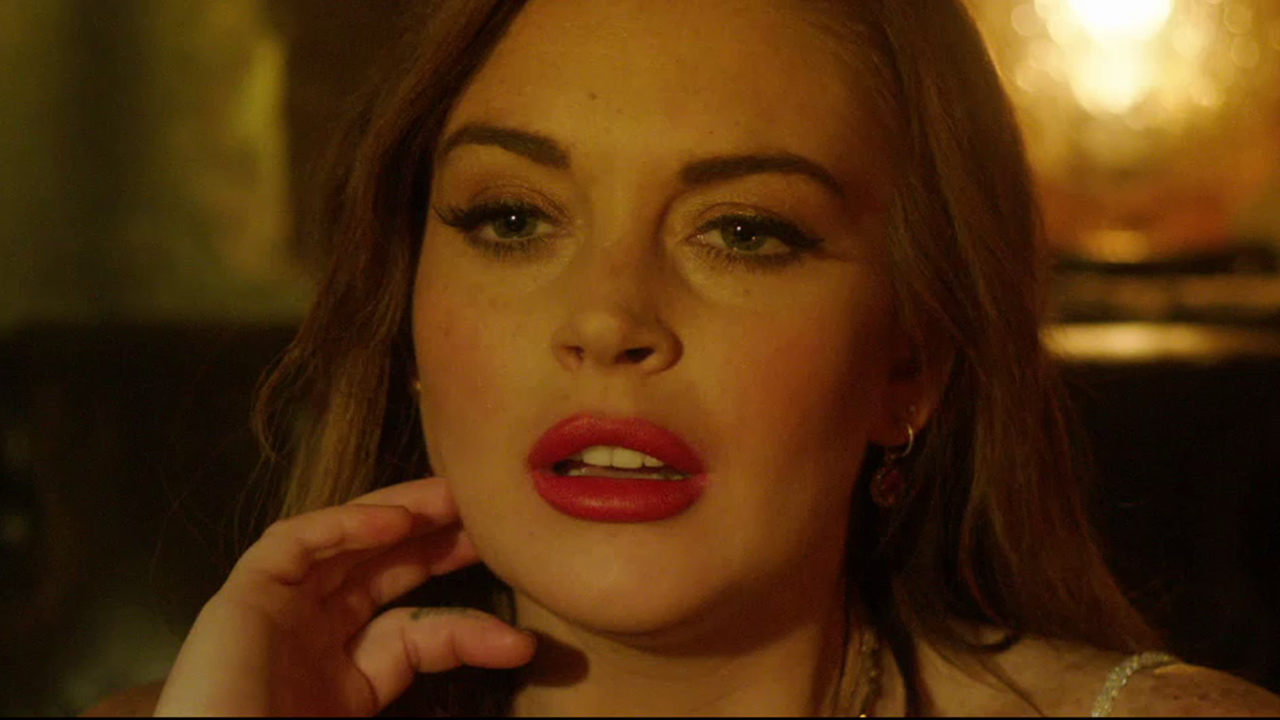"A close up of Lindsey Lohan in ""The Canyons"" with red lipstick on"