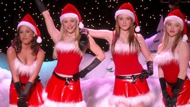 The 'Mean Girls' clique stands wearing Christmas outfits during their talent show performance.