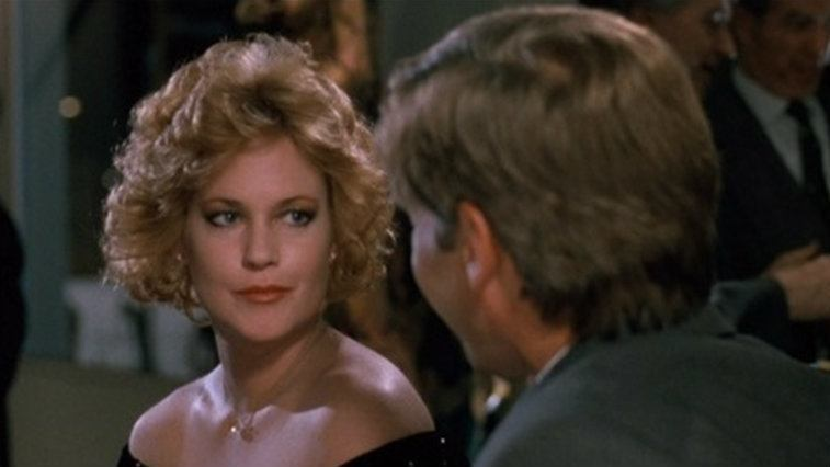 Melanie Griffith looks at a man in Working Girl