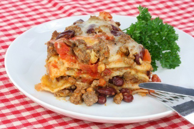 Mexican Taco Casserole with fork and knife in a plate