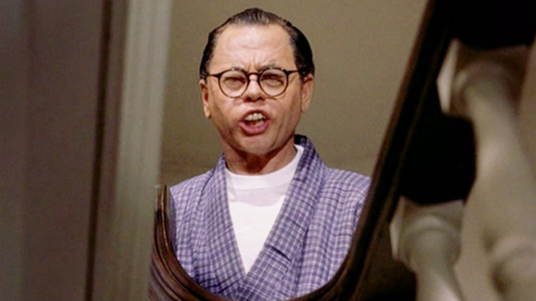 Mickey Rooney in Breakfast at Tiffany's making a face while looking in the mirror