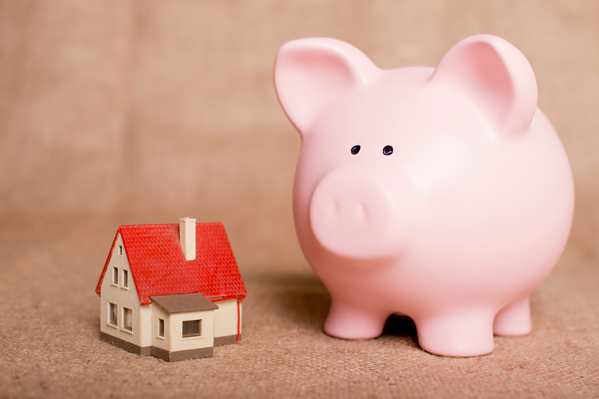 piggy bank beside a small house