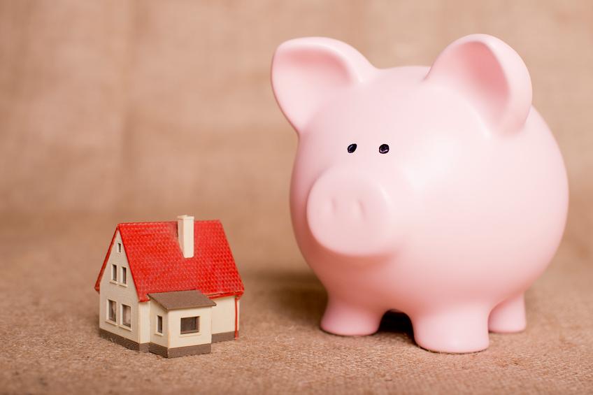 piggy bank beside a small house
