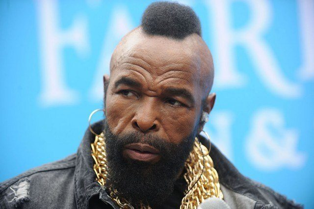 Mr. T with his mohawk and big chain looking serious
