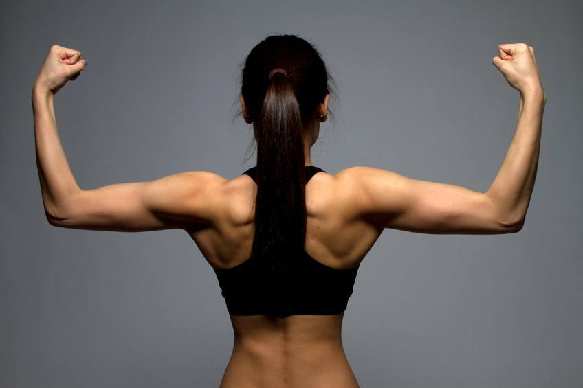 A woman flexing her arms