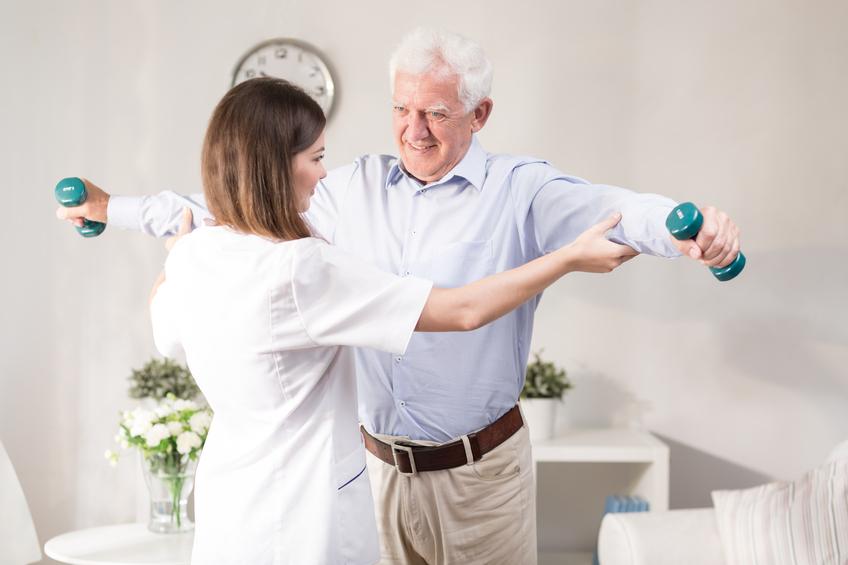 A nurse caring for an older man