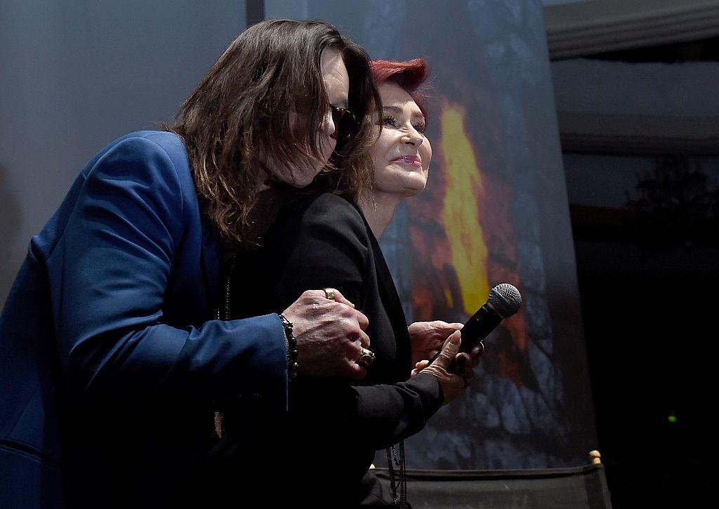 Ozzy Osbourne (L) and Sharon Osbourne holding microphone