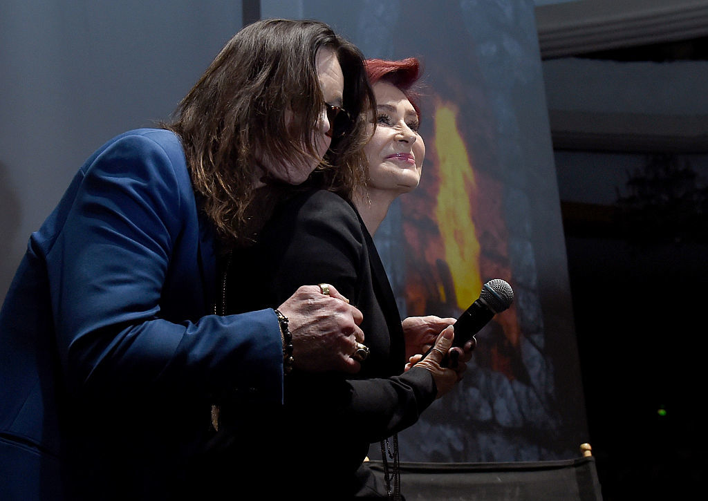 Ozzy Osbourne (L) and Sharon Osbourne holding microphone