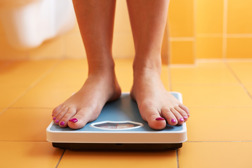 female feet on a weighing scale