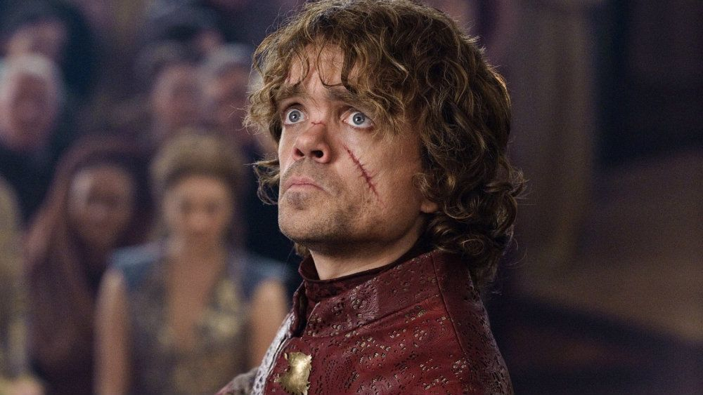 Peter Dinklage as Tyrion Lannister in Game of Thrones with a scar on his cheek, looking shocked