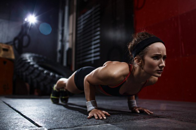 A woman performing a circuit workout