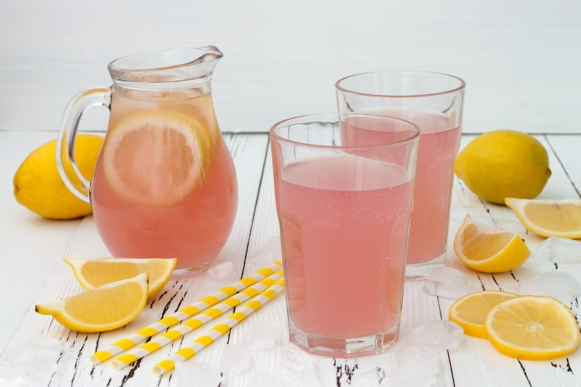 pink lemonade in a jug and glasses
