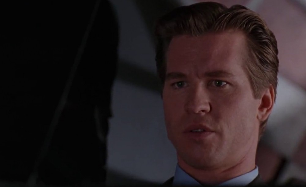 Val Kilmer as Batman in Batman Forever, looking shocked