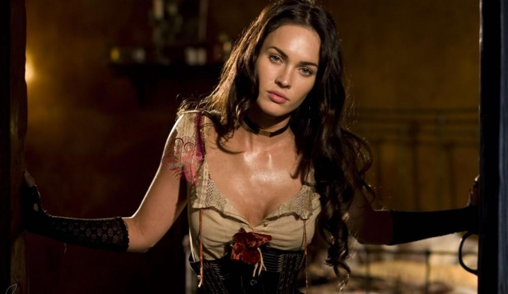 Megan Fox is in a ripped dress and black gloves in Jonas Hex.