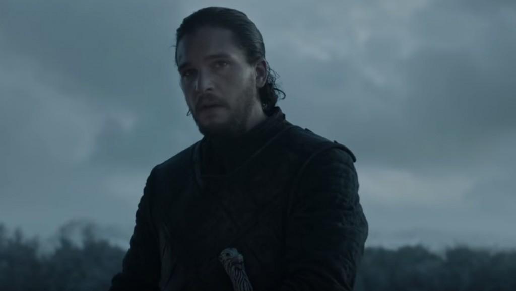 Jon Snow standing in a dark field, wearing black leather armor