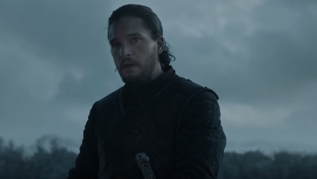 Jon Snow standing in a dark field, wearing black leather armor