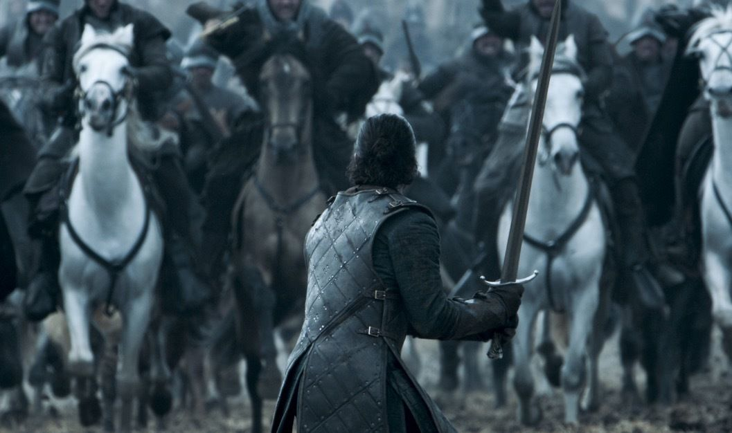 Jon Snow with his sword drawn, with an army charging directly at him