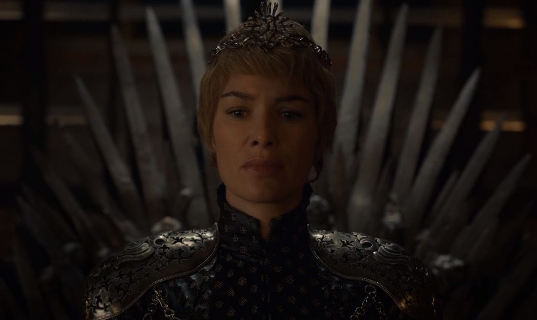 A newly-crowned Cersei sits on the Iron Throne, clad entirely in black leather