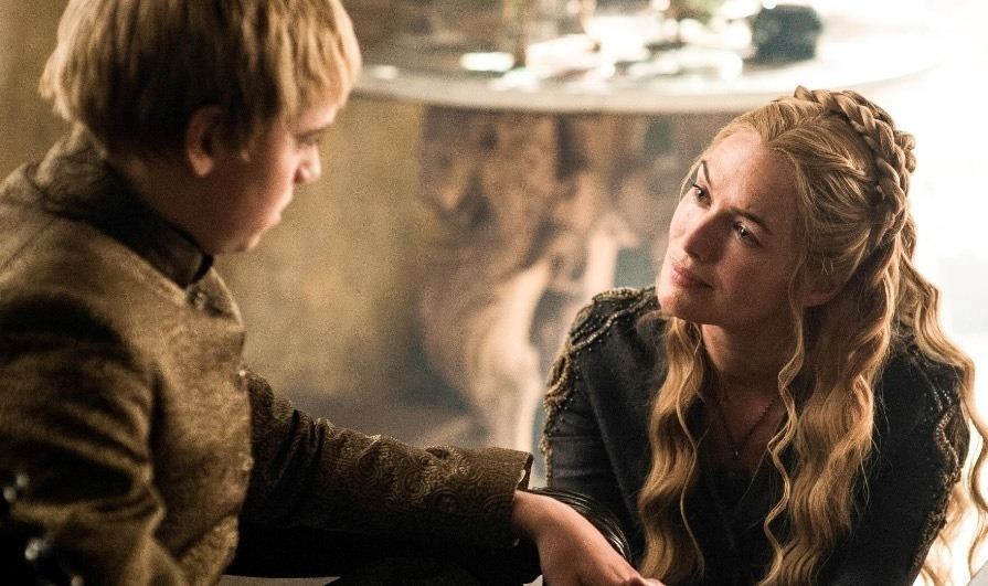Cersei Lannister looks at Tommen.