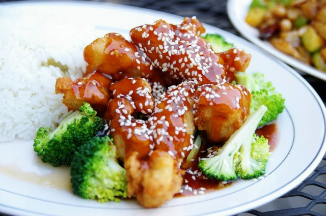 close up of sesame chicken in a plate