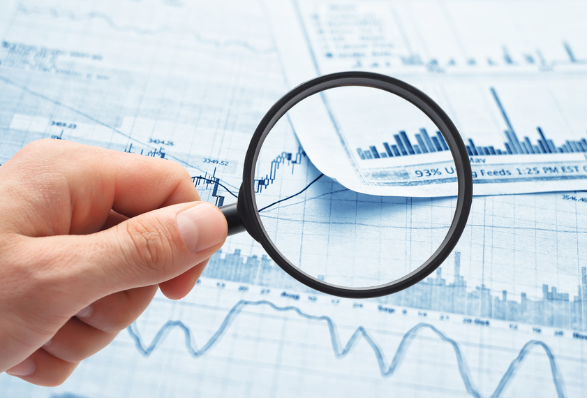 magnifying glass on a business report