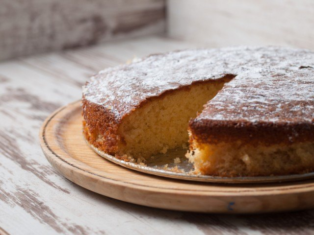 yellow cake with a slice missing