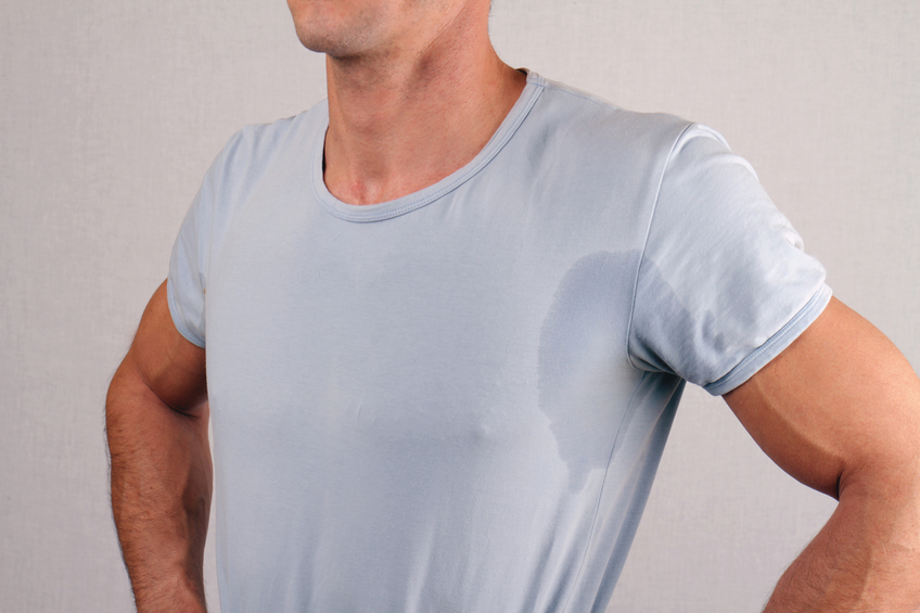 man wearing T-shirt and sweating