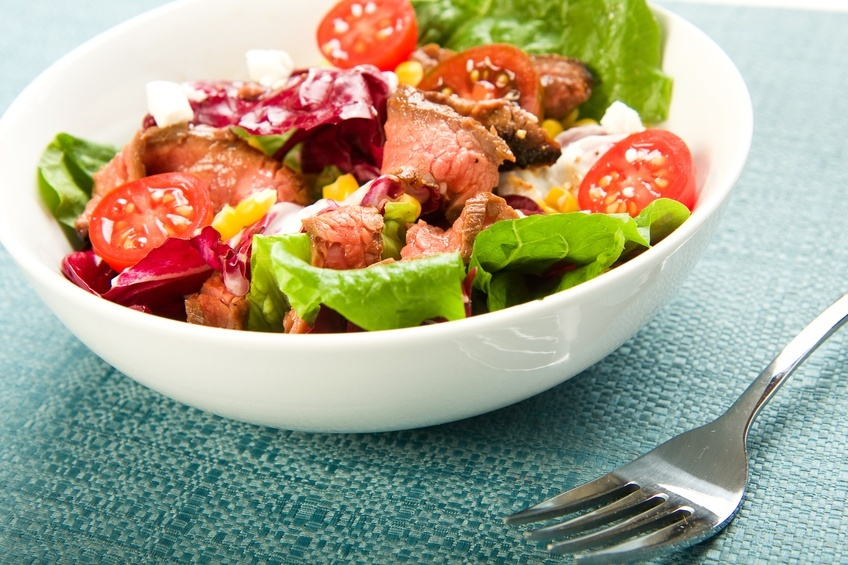Steak Salad in a white bowl with fork