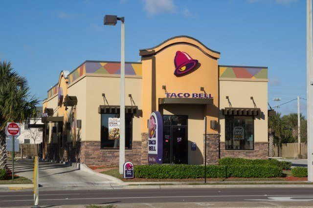 A Taco Bell restaurant on a sunny day.