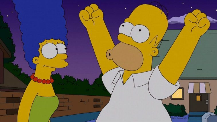Homer Simpson triumphantly raises his arms in the air