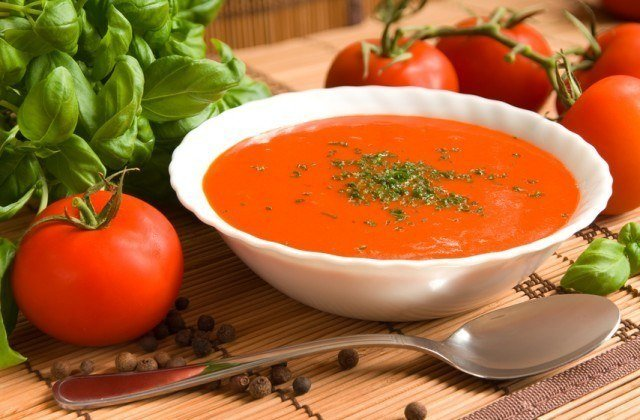 white bowl filled with tomato and basil soup