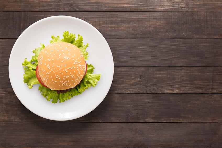 BBQ burger on white dish