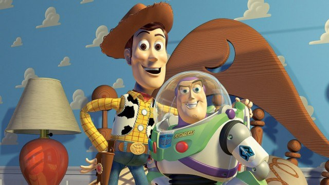 Woody puts his arm around Buzz Lightyear in Andy's room.
