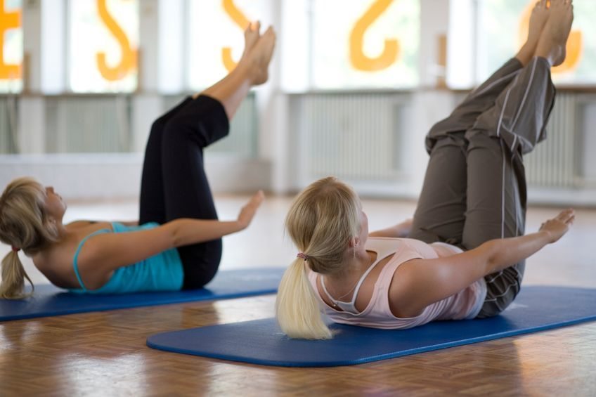 Two women doing Pilates
