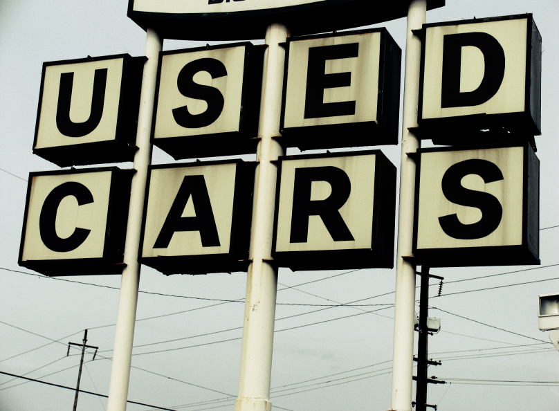 sign board saying 'used cars'
