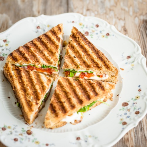 Vegetarian panini cut into four pieces