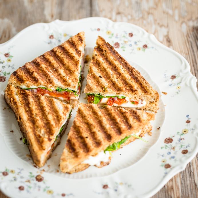 Vegetarian panini cut into four pieces