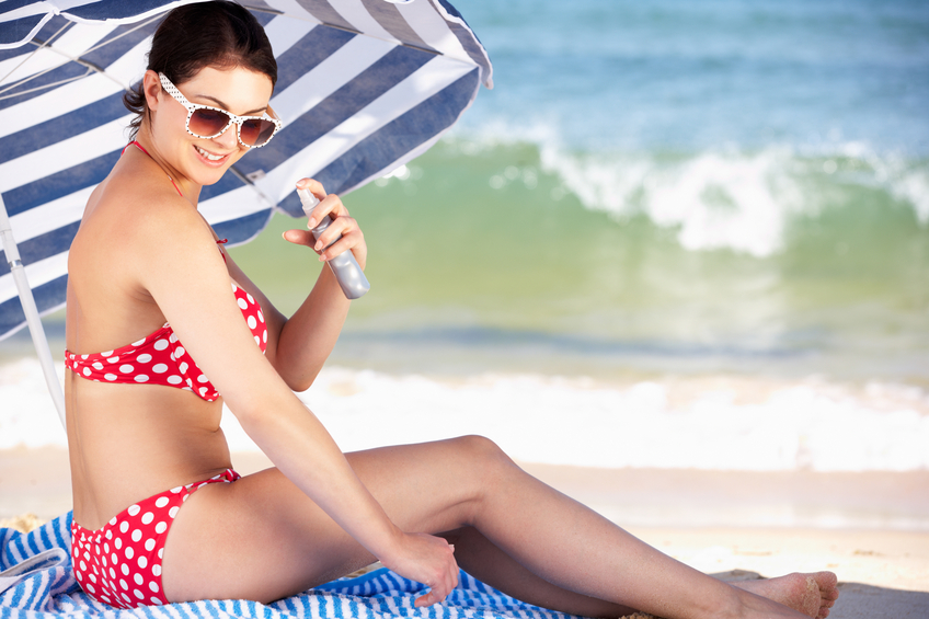woman under beach umbrella